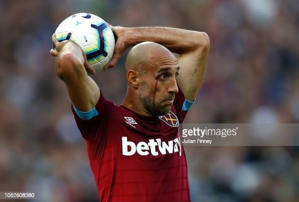 Pablo Zabaleta of West Ham takes a throw in during the Premier League match between West Ham United and Tottenham Hotspur at London Stadium on...