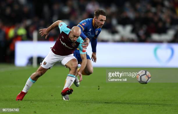 Pablo Zabaleta of West Ham United and Alex Rodman of Shrewsbury Town during the Emirates FA Cup Third Round Replay match between West Ham United and...