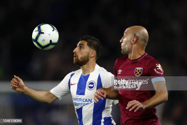 Pablo Zabaleta of West Ham United and Alireza Jahanbakhsh of Brighton and Hove Albion battle for possession during the Premier League match between...