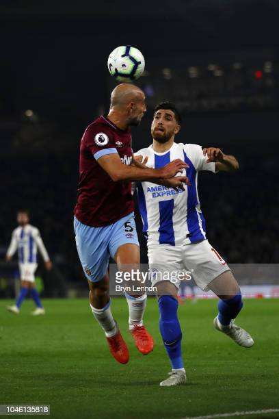 Pablo Zabaleta of West Ham United and Alireza Jahanbakhsh of Brighton and Hove Albion battle for possession in the air during the Premier League...