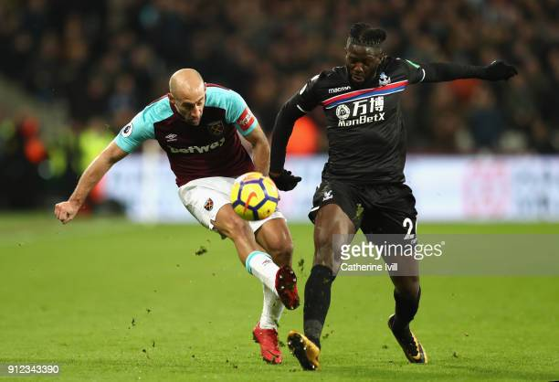 Pablo Zabaleta of West Ham United and Bakary Sako of Crystal Palace in action during the Premier League match between West Ham United and Crystal...