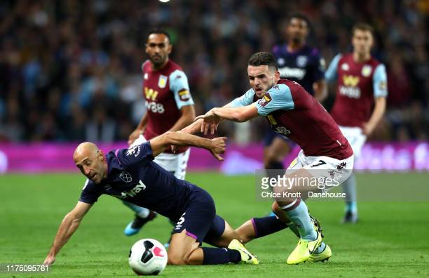 Pablo Zabaleta of West Ham United and John McGinn of Aston Villa in action during the Premier League match between Aston Villa and West Ham United at...