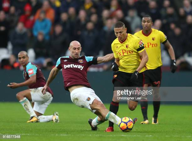 Pablo Zabaleta of West Ham United and Richarlison de Andrade of Watford battle for the ball during the Premier League match between West Ham United...