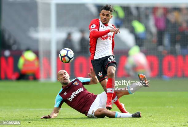 Pablo Zabaleta of West Ham United battles for possesion with Sofiane Boufal during the Premier League match between West Ham United and Southampton...