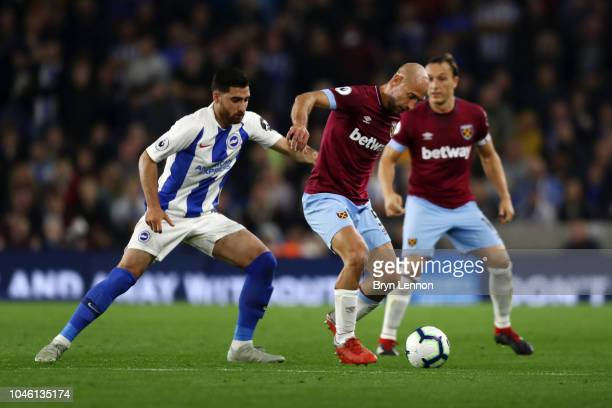 Pablo Zabaleta of West Ham United battles for possession with Alireza Jahanbakhsh of Brighton and Hove Albion during the Premier League match between...