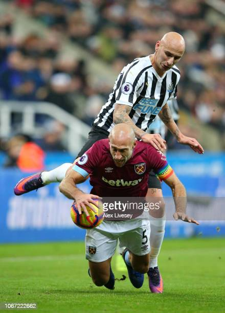 Pablo Zabaleta of West Ham United is challenged by Jonjo Shelvey of Newcastle United during the Premier League match between Newcastle United and...