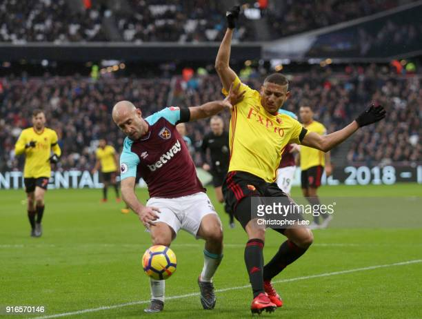 Pablo Zabaleta of West Ham United is challenged by Richarlison de Andrade of Watford during the Premier League match between West Ham United and...