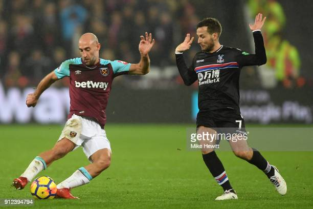 Pablo Zabaleta of West Ham United is challenged by Yohan Cabaye of Crystal Palace during the Premier League match between West Ham United and Crystal...