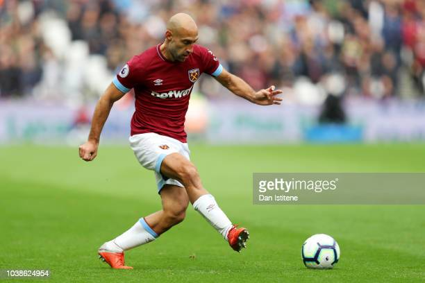 Pablo Zabaleta of West Ham United passes the ball during the Premier League match between West Ham United and Chelsea FC at London Stadium on...