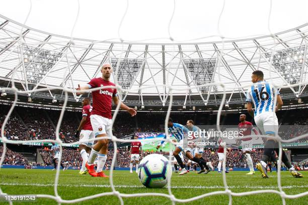 Pablo Zabaleta of West Ham United reacts after Juninho Bacuna of Huddersfield Town scored his team's first goal during the Premier League match...