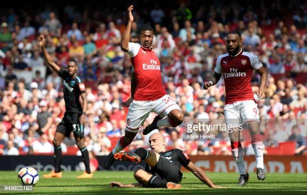 Pablo Zabaleta of West Ham United tackles Ainsley MaitlandNiles of Arsenal during the Premier League match between Arsenal and West Ham United at...