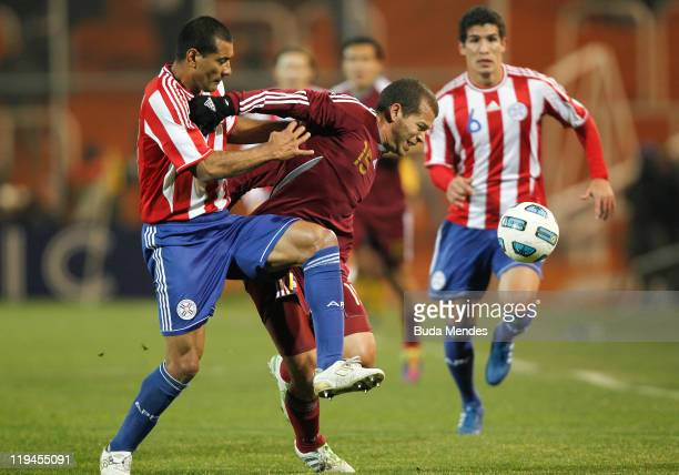 Pablo Zeballos of Paraguay struggles for the ball with Alejandro Moreno of Venezuela during a match as part of Copa America 2011 Semifinal at...