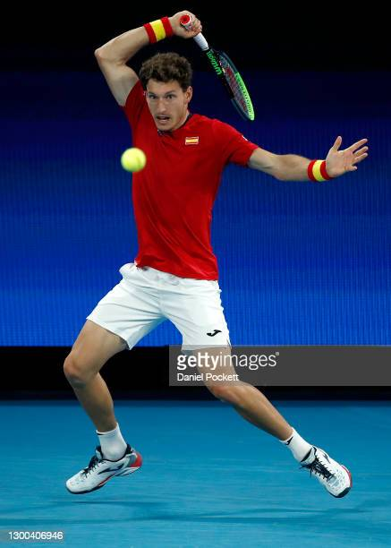 PabloCarreno Busta of Spain plays a forehand in his Group B singles match against MichailPervolarakis of Greece during day four of the 2021 ATP Cup...