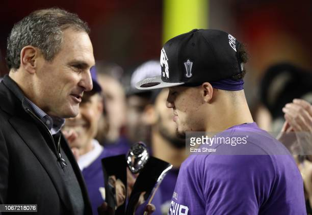 Pac 12 Commissioner Larry Scott gives Byron Murphy of the Washington Huskies the MVP trophy after the Huskies beat the Utah Utes to win the Pac 12...