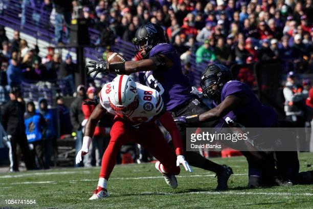 Pace of the Northwestern Wildcats intercepts a pass against the Nebraska Cornhuskers during the second half on October 13 2018 at Ryan Field in...