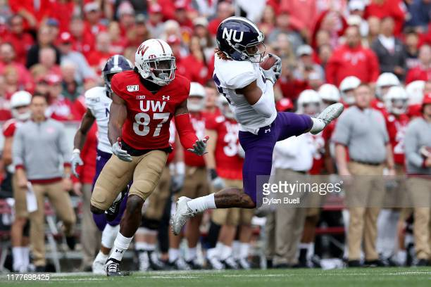Pace of the Northwestern Wildcats intercepts a pass in front of Quintez Cephus of the Wisconsin Badgers in the second quarter at Camp Randall Stadium...