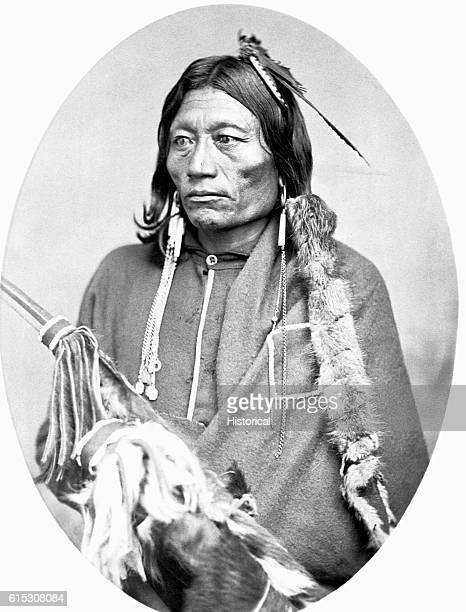 Pacer a KiowaApache chief halflength seated wearing earrings 18681874 | Location in a studio