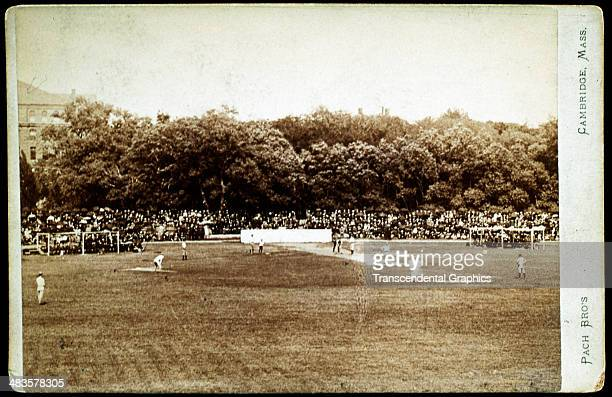Pach Brothers photographers present this field action photograph of a baseball game in progress involving Harvard University around 1880 in Cambridge...