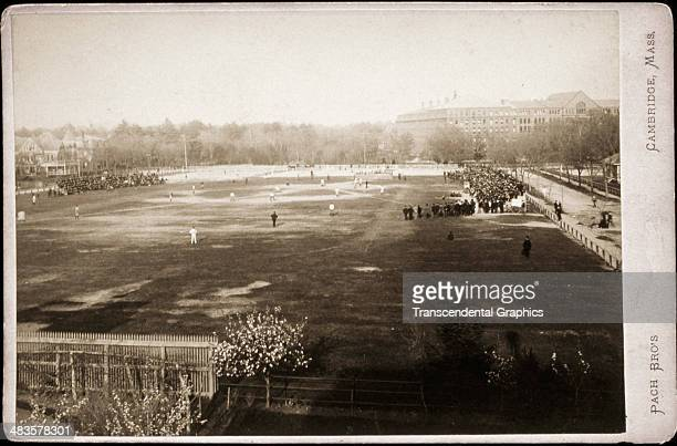 Pach Brothers photographers present this full field photograph of a baseball game in progress involving Harvard University around 1880 in Cambridge...