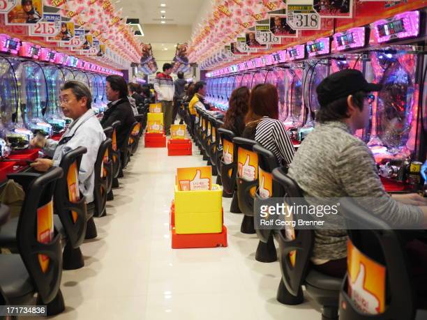 Pachinko parlor or casino in Okobatamachi. Pachinko is a gambling sometimes an arcade game it's a pinball game comparable to western slot machines.