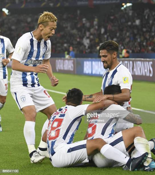 Pachuca players celebrate the team's gamewinning 112thminute extratime goal by Victor Guzman in a 10 victory over Wydad Casablanca in the Club World...