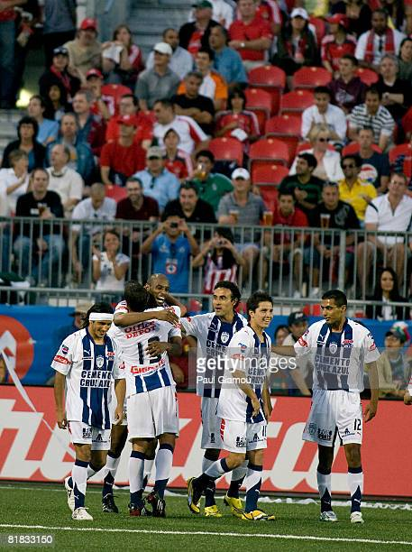 Pachuca teammates celebrate after their first goal against Toronto FC on July 5 2008 at BMO Field in Toronto Canada