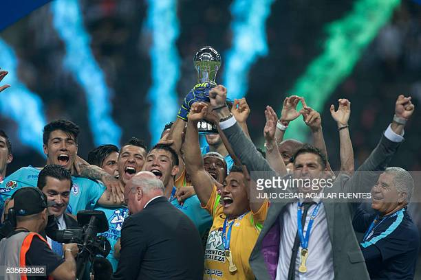 Pachuca's footballers celebrate with the trophy after defeating Monterrey during their Mexican Clausura 2016 tournament football final match at the...