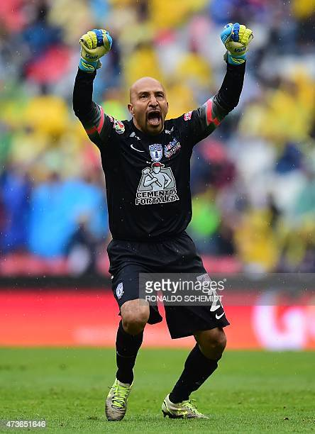 Pachuca's goalkeeper Oscar Perez celebrates a goal against America during their Mexican Clausura tournament match at the Azteca stadium in Mexico...