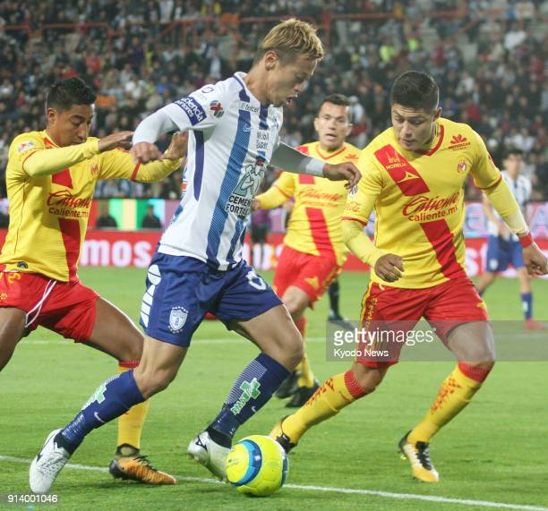 Pachuca's Japan international Keisuke Honda tries to fend off Monarcas Morelia's Jorge Valadez during the second half of his side's 32 defeat in...