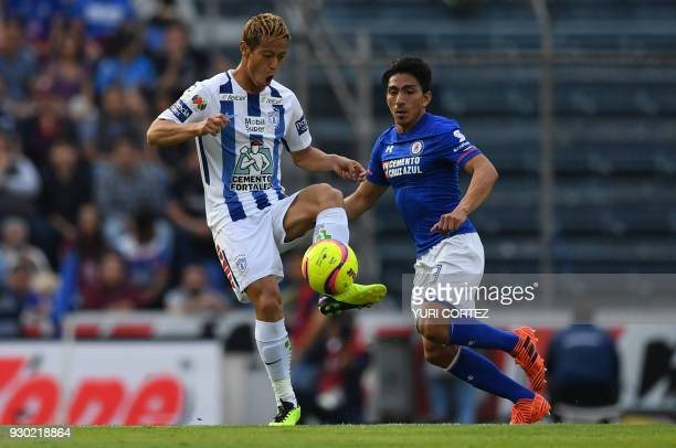 Pachuca's Japanese midfielder Japanese Keisuke Honda controls the ball as Cruz Azul's forward Angel Mena looks on during their Mexican Clausura...