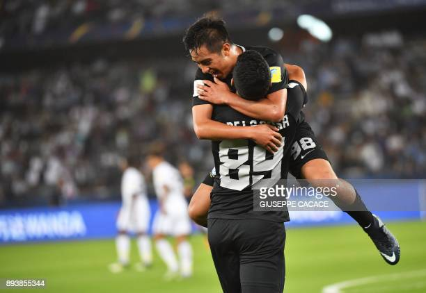 CF Pachuca's Mexican forward Roberto De La Rosa celebrates with his teammate Erick Sanchez after scoring a goal during the thirdplace playoff...