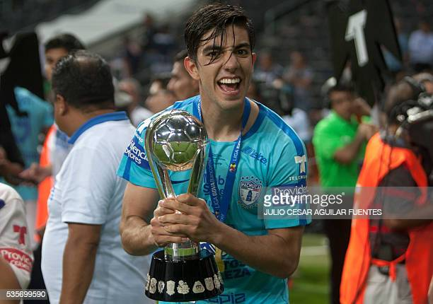 Pachuca's Rodolfo Pizarro celebrates with the trophy after defeating Monterrey during their Mexican Clausura 2016 tournament football final match at...