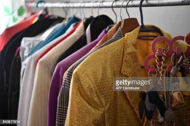 Pachuco style suits known as 'Zoot Suit' are photographed in a house of a Pachuco in Tepito neighborhood in Mexico City on August 22 2017 Wearing...