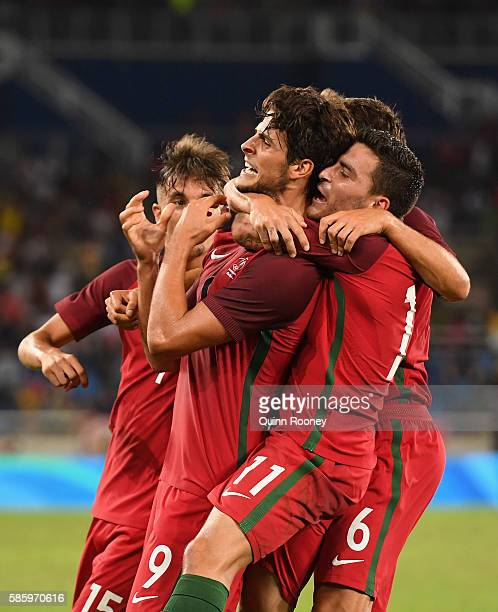 Paciencia Goncalo of Portugal celebrates his goal with his teammates during the Men's Group D first round match between Portugal and Argentina during...