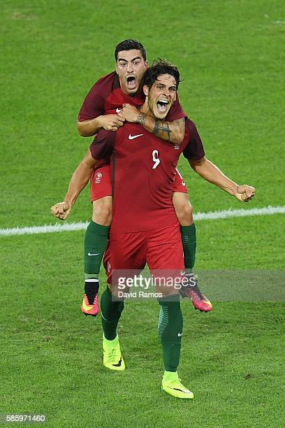 Paciencia Goncalo of Portugal celebrates with his team after scoring during the Men's Group D first round match between Portugal and Argentina during...