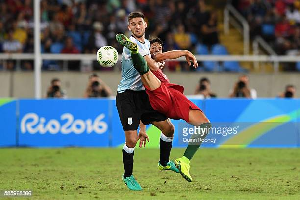 Paciencia Goncalo of Portugal tackles his opponent during the Men's Group D first round match between Portugal and Argentina during the Rio 2016...