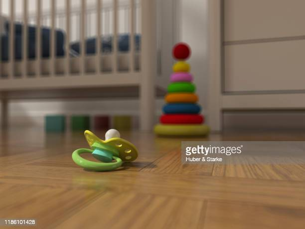 pacifer lying on the parquet floor - child behind bars stock pictures, royalty-free photos & images