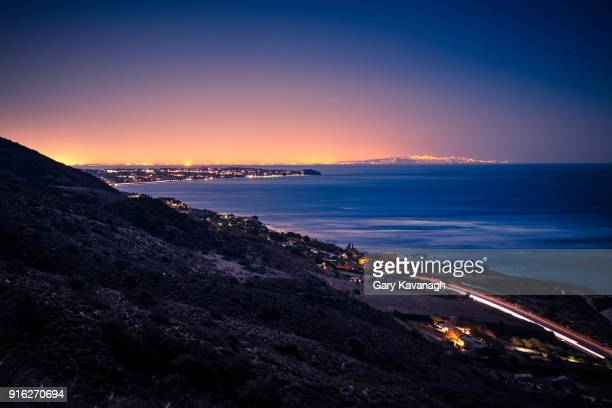 pacific coastline from hills above leo carrillo at night. - malibu stock pictures, royalty-free photos & images
