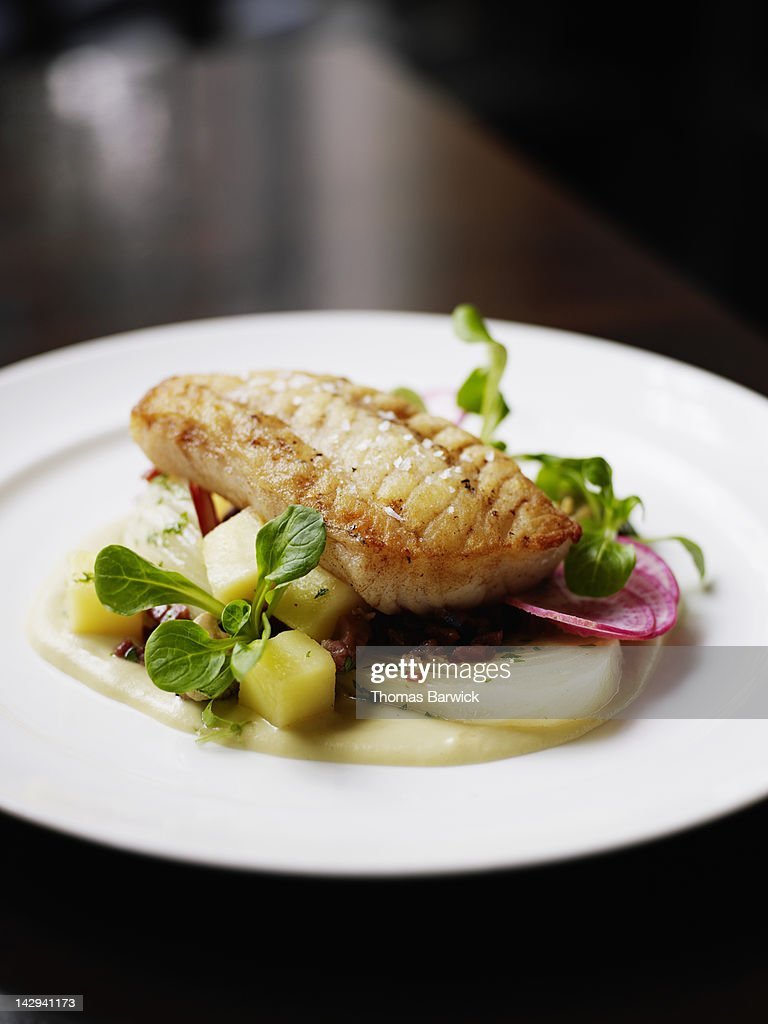 Pacific cod, fennel, potatoes, proscuitto, mussels : Stock Photo