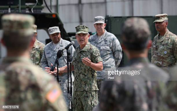 S Pacific Command Commander Adm Harry Harris answers a reporter's question as US and South Korean soldiers listen during a press conference as Lt Gen...