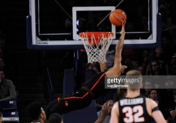 Pacific guard Roberto Gallinat is called for a technical foul for tapping the ball into the basket while grabbing onto the rim on this play during...