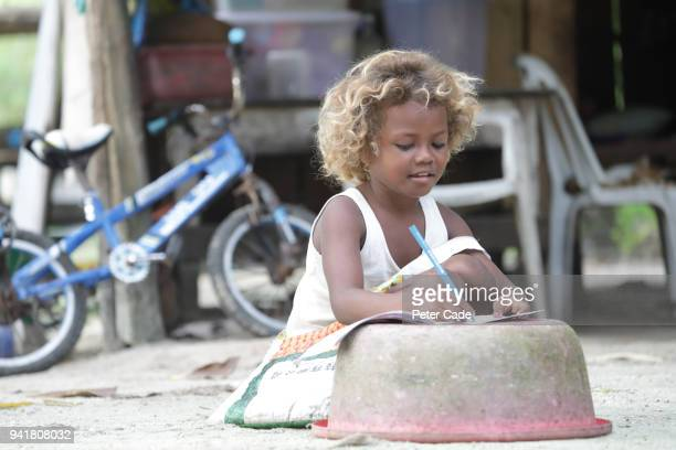Pacific Island child doing homework