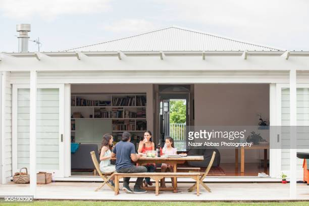 pacific island family enjoying meal at home. - housing difficulties stock pictures, royalty-free photos & images