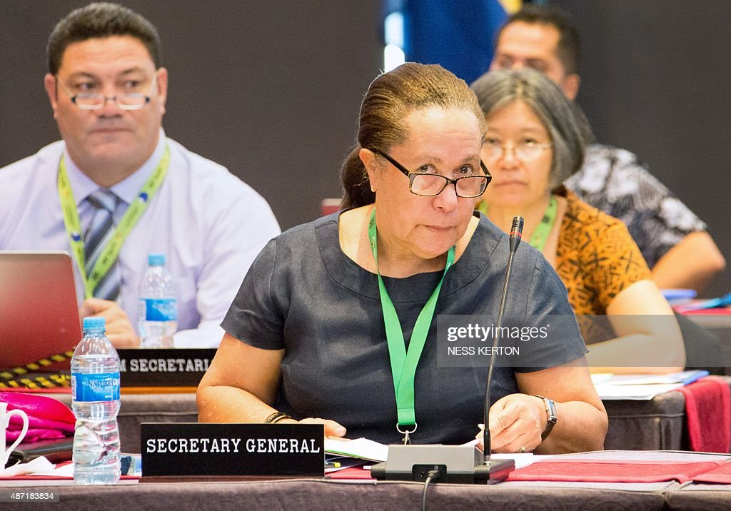 Pacific Island Forum Secretary-General Dame Meg Taylor (C) listens to a speaker during the Smaller Islands States Leaders meeting as part of the Pacific Islands Forum in Port Moresby, Papua New Guinea, on September 7, 2015. Vulnerable Pacific island nations will this week send the world an urgent plea for action on climate change at crunch talks in Paris later this year. Some Pacific Islands Forum (PIF) countries lie barely a metre (three feet) above sea level and fear they will disappear beneath the waves without drastic intervention from major polluters. AFP PHOTO / Ness KERTON