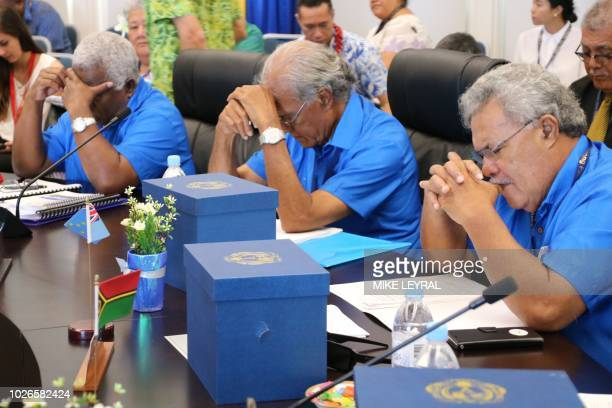 Pacific island leaders say a prayer before the start of the Pacific Islands Forum at the Civic Center in Aiwo on the island of Nauru on September 4...