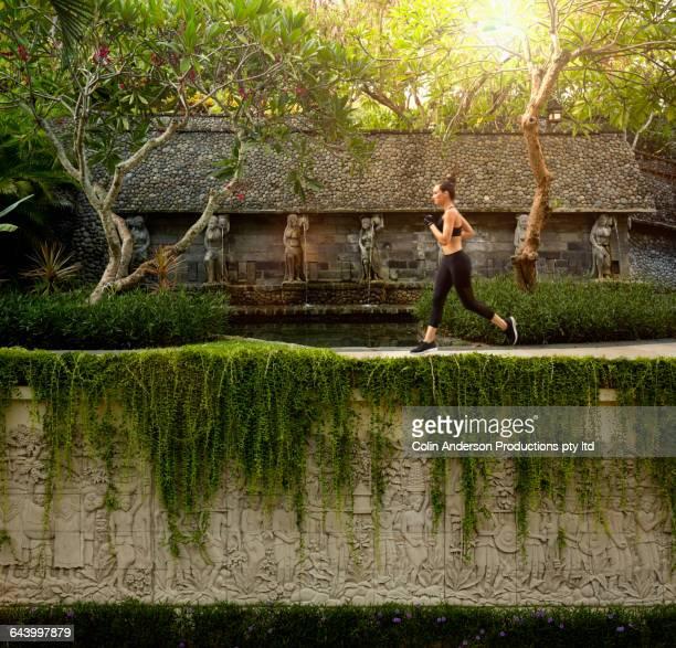 Pacific Islander athlete jogging in garden