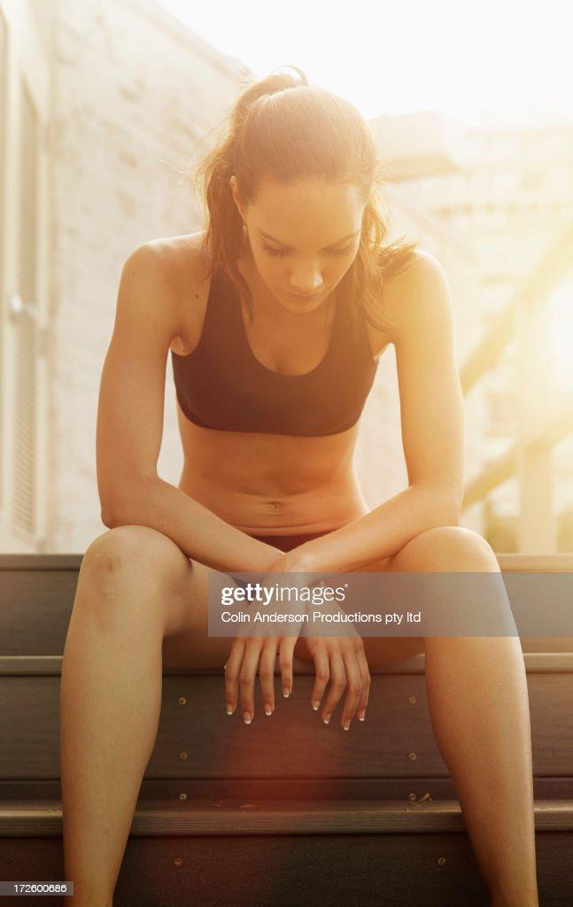 Pacific Islander athlete sitting on steps : Stock Photo