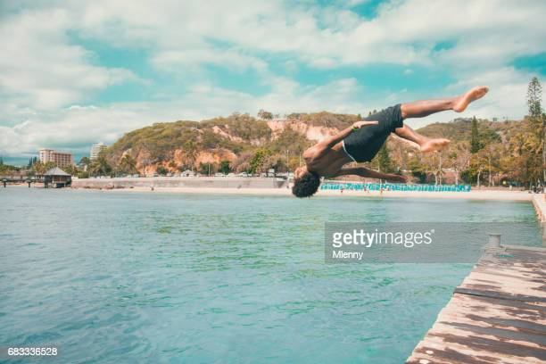Pacific Islander Backflip into the Water Noumea Beach New Caledonia