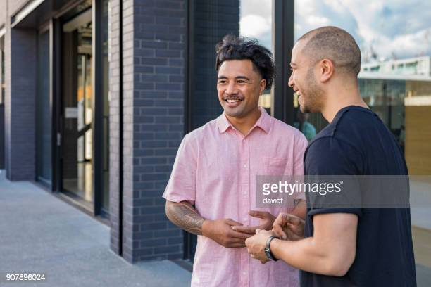 Pacific Islander Business Men Meeting Outside an Office Building