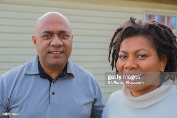 Pacific Islander couple smiling outdoors
